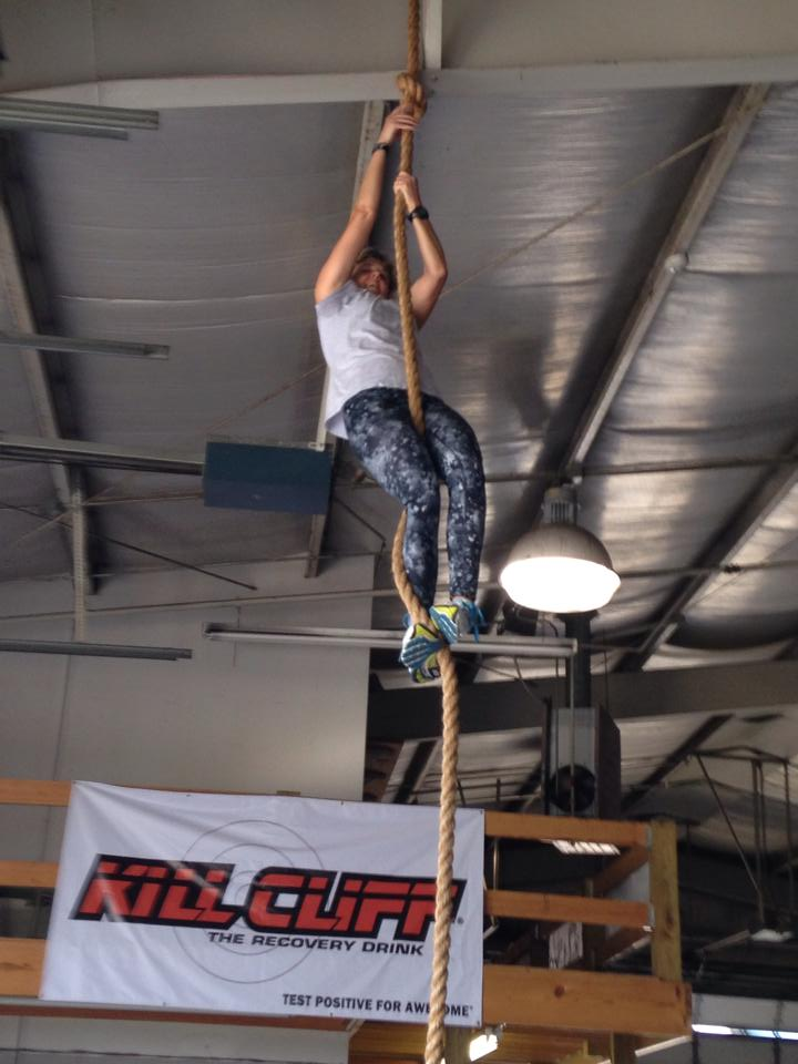 Reaching the top of the 16' rope at Iron House CrossFit.